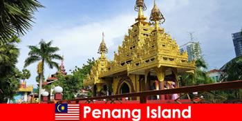 पेनांग द्वीप के मंदिर परिसरों में विदेशी पर्यटकों के अनुभव के लिए शीर्ष अनुभव