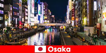 मनोरंजन जिलों और व्यंजनों ओसाका जापान में विदेशी यात्रियों का इंतजार